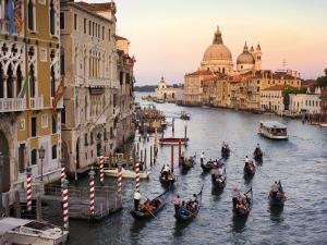 Flotilla of Gondolas Heading Toward Chiesa Di Santa Maria Della Salute in Early Evening by Christopher Groenhout