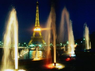 The Eiffel Tower at Night with Fountains in the Foreground, Paris, France