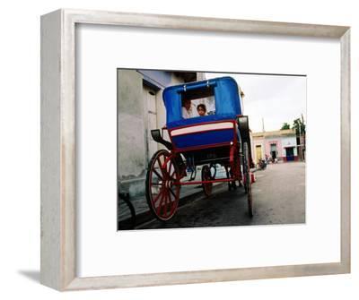 Girl in Horse-Drawn Carriage Taxi, Parque Cespedes, Bayamo, Cuba