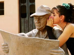 Girl in Quincinera (15th) Birthday Dress Whispering to Statue, Plaza Del Carmen, Camaguey, Cuba by Christopher P Baker