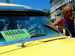 Man with 1950's Taxi, Havana, Cuba by Christopher P Baker