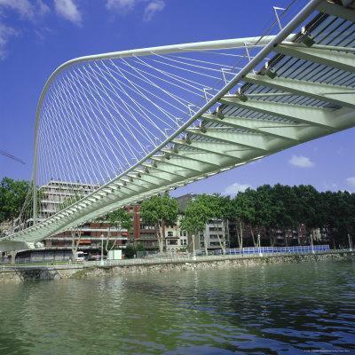 Zubizuri Curved Pedestrian Bridge Over Bilbao River, Bilbao, Pais Vasco (Vizcaya), Spain, Europe