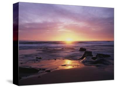 California, San Diego, Sunset Cliffs, Sunset over a Beach and Ocean
