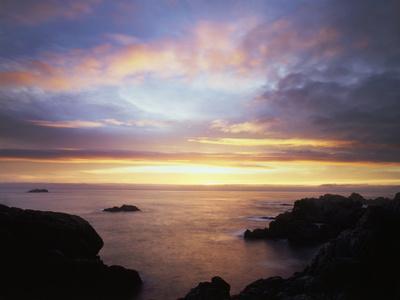 USA, California, San Diego, Sunset over Rocks on the Pacific Ocean