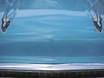 Chrome Decorations on Front of Blue Car--Photographic Print