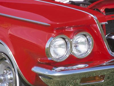 Chrome Headlight in Red Antique Car--Photographic Print