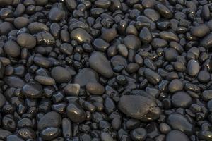 Black pebbles on the beach, Snaefellsnes Peninsula, Iceland by Chuck Haney