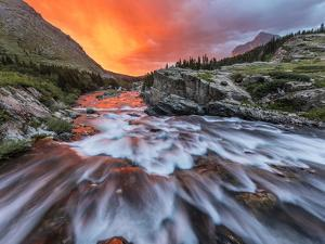 Brilliant Sunrise Sky over Swiftcurrent Falls in Glacier National Park, Montana, Usa by Chuck Haney