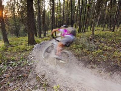 Courtney Feldt Mountain Bikes on Singletrack of the Whitefish Trail Near Whitefish, Montana, Usa