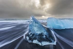 Diamond ice chards from calving icebergs on black sand beach, Jokulsarlon, south Iceland by Chuck Haney