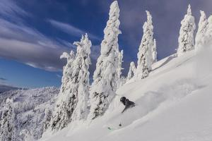 First Tracks on Evans Heaven on Sunny Powder Morning at Whitefish Mountain Resort, Montana by Chuck Haney