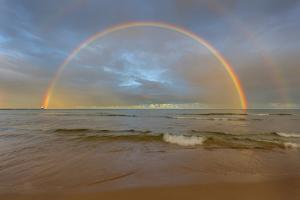Full Arcing Rainbow over Lake Michigan and Ludington Lighthouse in Ludington, Michigan, Usa by Chuck Haney