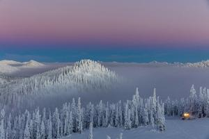 Groomer at Dusk at Whitefish Mountain Resort in Whitefish, Montana, Usa by Chuck Haney