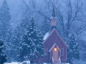 Historic Yosemite Valley Chapel During Heavy Snowfall in Yosemite National Park, California, USA by Chuck Haney