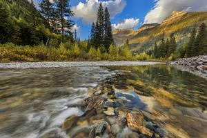 Mcdonald Creek with the Garden Wall in Glacier National Park, Montana, Usa by Chuck Haney