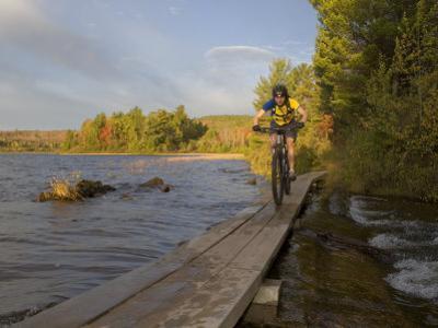 Mountain Biker along The Red Trail, Copper Harbor, Michigan, USA