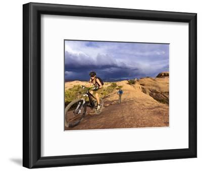 Mountain Bikers on the Slickrock Trail in Moab, Utah, Usa