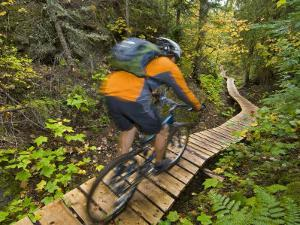 Mountain biking on the Stairway to Heaven Trail, Copper Harbor, Michigan, USA by Chuck Haney