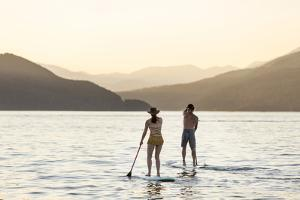 Paddleboarding on Whitefish Lake at Sunset in Whitefish, Montana, USA by Chuck Haney