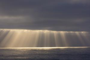 Rays from the Clouds over the Pacific Ocean, Santa Cruz, California by Chuck Haney