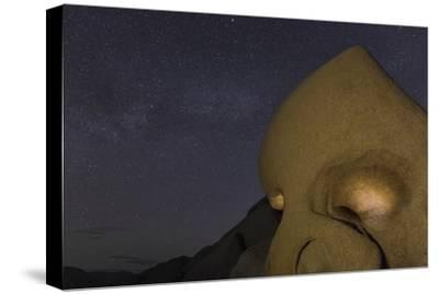 Skull Rock Lit Up at Night in Joshua Tree NP, California, USA
