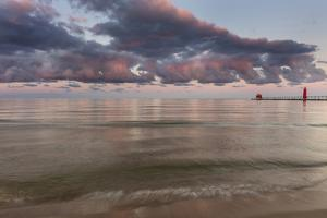 Sunrise Clouds over Lake Michigan and the Grand Haven Lighthouse in Grand Haven, Michigan, Usa by Chuck Haney