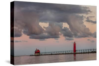 Sunrise Clouds over Lake Michigan and the Grand Haven Lighthouse in Grand Haven, Michigan, Usa