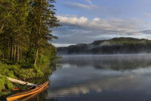 Sunrise with Kayak on Beaver Lake in the Stillwater State Forest Near Whitefish, Montana, Usa by Chuck Haney