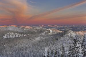 Sunset over the Whitefish Range and Flower Point in Whitefish, Montana by Chuck Haney