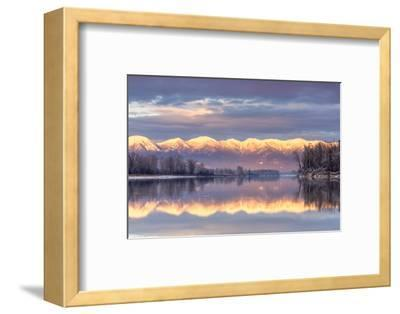 Swan Mountains Reflect into the Flathead River, Sunset, Montana, USA