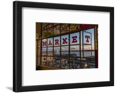 The Great Wheel Framed in Pike Market Place Windows in Seattle, Washington State, Usa