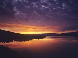 Vivid Sunrise over St Mary Lake in Glacier National Park, Montana, USA by Chuck Haney