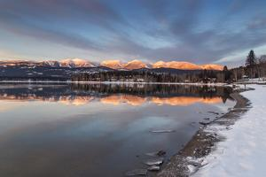 Whitefish Lake Reflecting Big Mountain in Winter Sunset, Montana, USA by Chuck Haney
