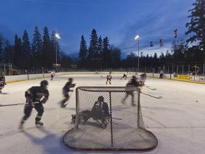 Youth Hockey Action at Woodland Park in Kalispell, Montana, USA by Chuck Haney