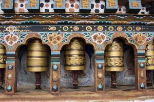 Bhutan, Paro, capital of Paro District, Dzongkhag. Traditional prayer wheels. by Cindy Miller Hopkins