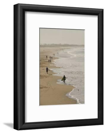 Surfer and People on Pismo State Beach, Pismo Beach, California, USA
