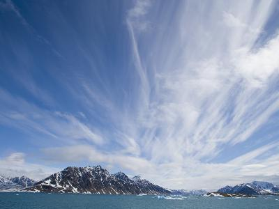 Cirrus Clouds Over Fjord in June-Theo Allofs-Photographic Print