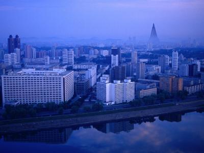City Skyline from 17 Yanggakdo Hotel, P'Yongyang, North Korea-Tony Wheeler-Photographic Print