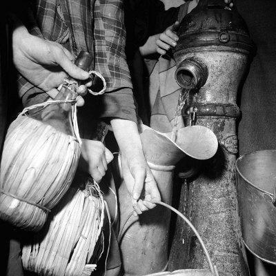 https://imgc.artprintimages.com/img/print/civilians-filling-wine-jugs-with-fresh-water-after-city-was-restored-in-the-wake-of-germans-wwii_u-l-p6928u0.jpg?p=0