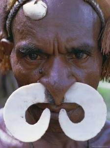 Portrait of an Asmat Man with Nose Ornament, Papua New Guinea, Pacific by Claire Leimbach
