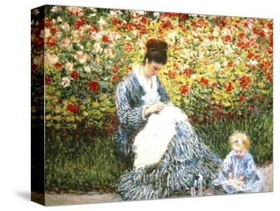 Madame Monet and Child in a Garden