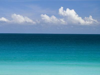 Clear Blue Water and White Puffy Clouds Along the Beach at Cancun-Michael Melford-Photographic Print