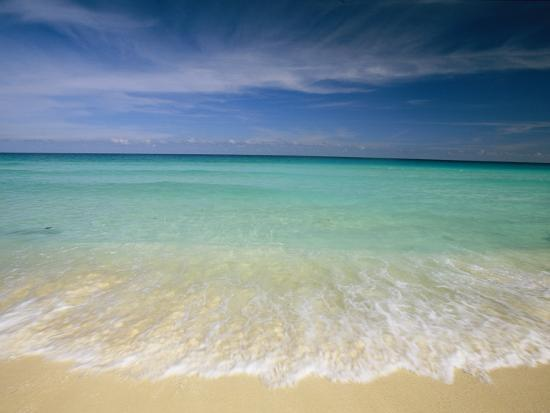 Clear Blue Water and Wispy Clouds Along the Beach at Cancun-Michael Melford-Photographic Print
