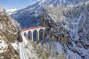 Bernina Train at Landwasser Viaduct, UNESCO World Heritage, Engadine, Switzerland by ClickAlps
