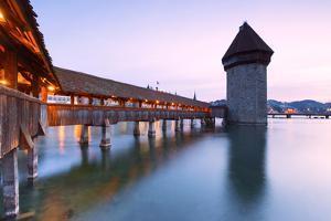 Europe, Switzerland, Lucerne. Bridge at dusk by ClickAlps