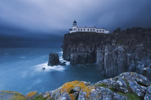 Rocky Cliff on the Sea, with a Lighthouse on the Reef, Neist Point, Isle of Skye, Scotland, Uk by ClickAlps