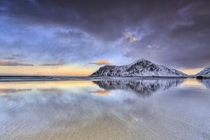 Sunset on Skagsanden Beach Surrounded by Snow Covered Mountains, Lofoten Islands by ClickAlps