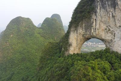 Climber on Natural Arch Formed at Moon Hill, Yangshuo, Guangxi Province, China-Chad Copeland-Photographic Print