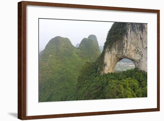 Climber on Natural Arch Formed at Moon Hill, Yangshuo, Guangxi Province, China-Chad Copeland-Framed Photographic Print