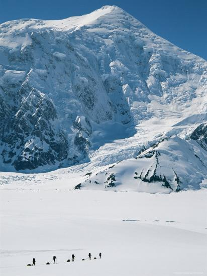Climbers Hike Through a Snowy Landscape on Their Way to Denali-Bill Hatcher-Photographic Print